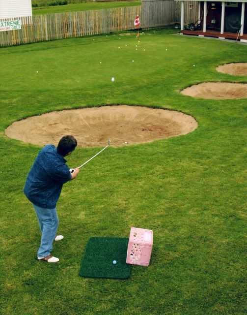 step onto a fully functional extreme backyard golf course i began